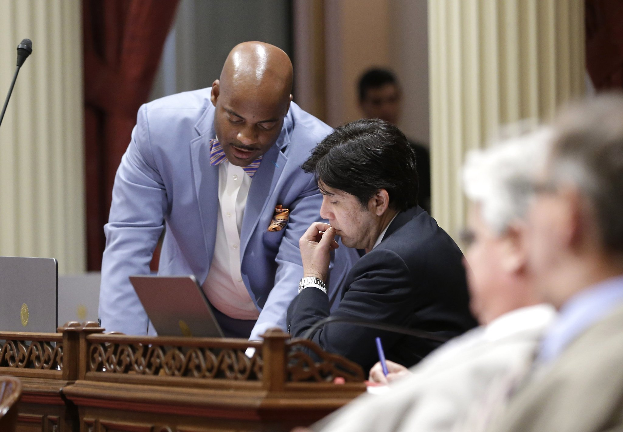 Former State Sen. Isadore Hall III, left, of Compton talks last year with Senate President Pro Tem Kevin de Leon (D-Los Angeles) in Sacramento. (Rich Pedroncelli / Associated Press)
