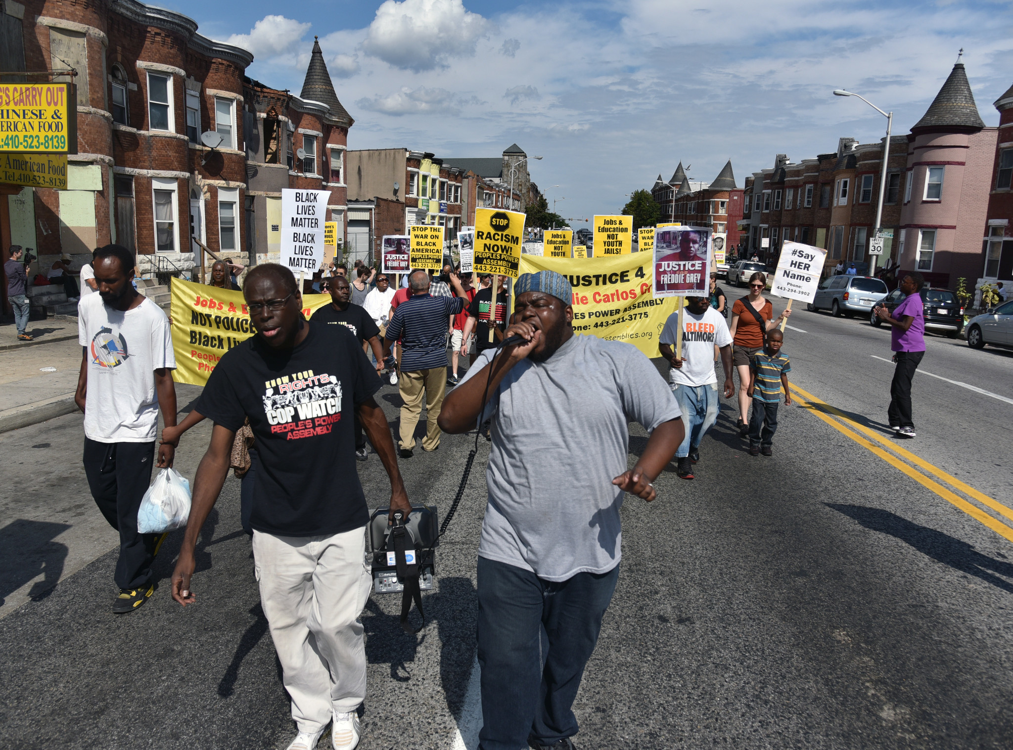protesters march against police brutality on anniversary of ferguson