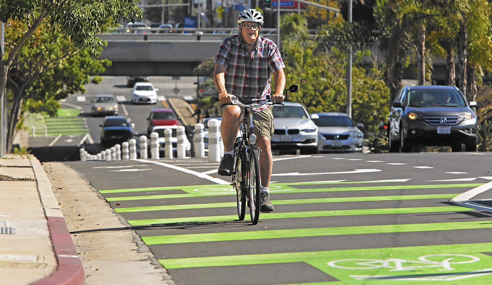 A protected bike lane on Reseda Boulevard in Northridge. (Anne Cusack / Los Angeles Times)