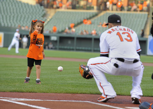 """<p>Hailey Dawson, a 5-year-old from Las Vegas, thows out the ceremonial first pitch at Camden Yards. Hailey was born with Poland Syndrome. Engineering students at the University of Nevada, Las Vegas created the """"Flexy Hand 2"""" that she wore to throw the ball.</p>"""