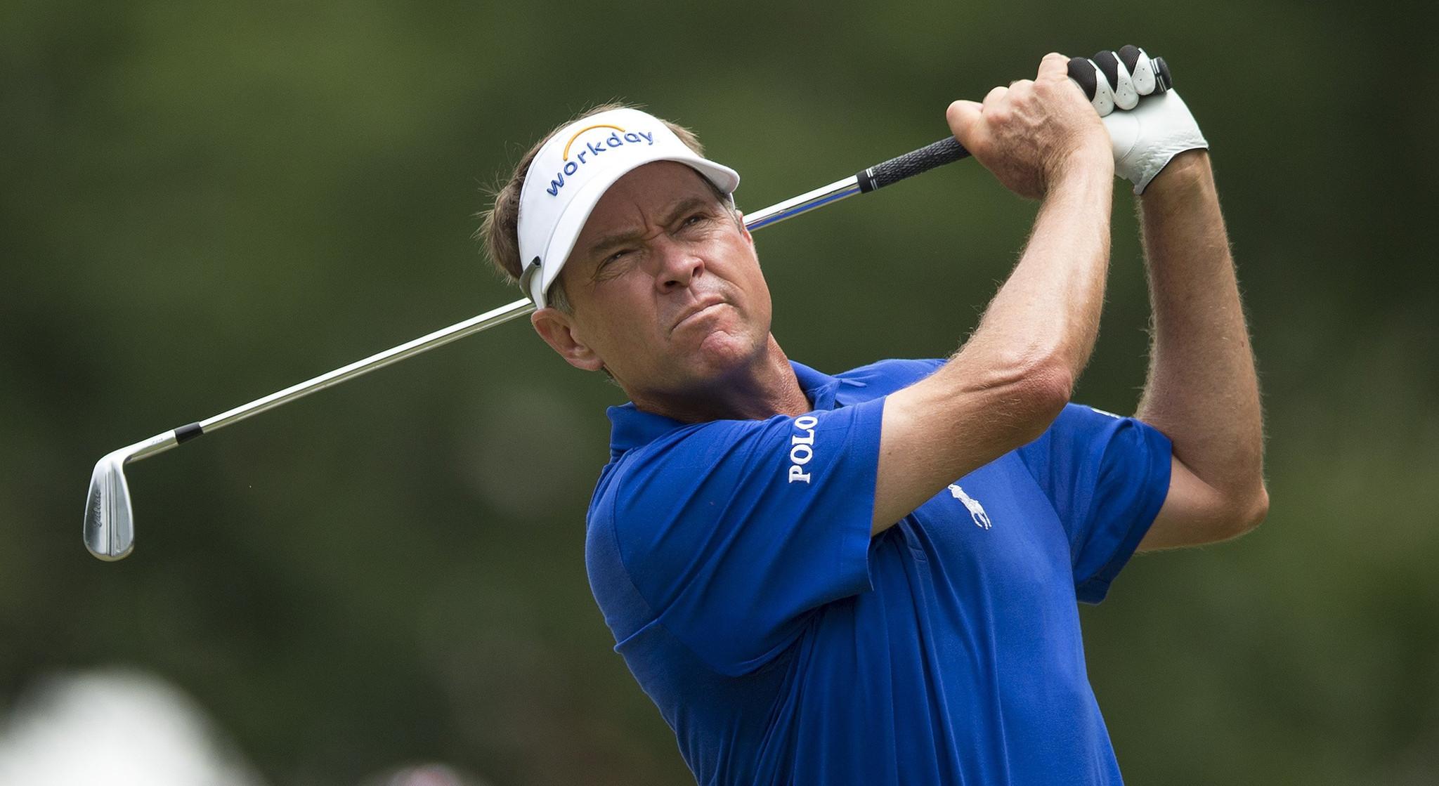 Davis Love III wins Wyndham as Tiger Woods struggles in final round