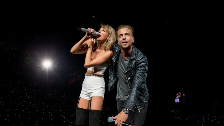 Taylor Swift and Ryan Tedder performing on The 1989 World Tour.