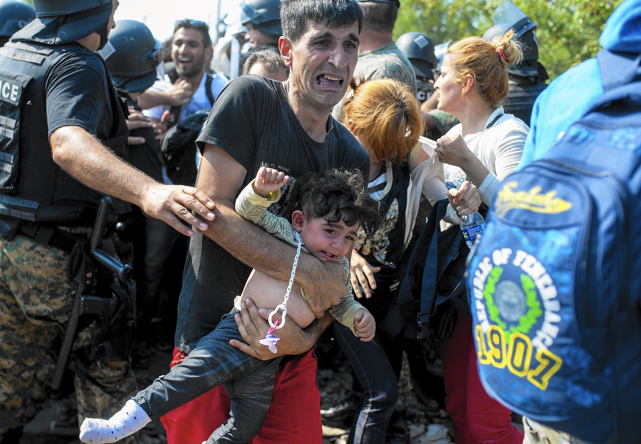 Macedonia border camp helps send migrants on their way