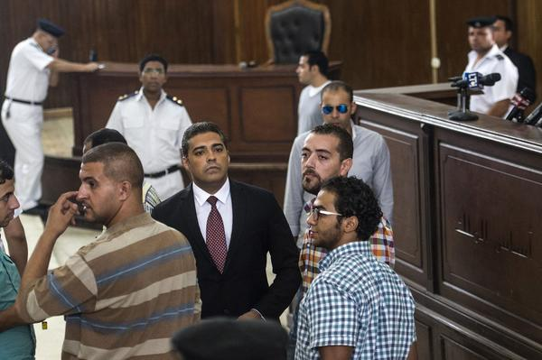 Egypt sentences 3 Al Jazeera English reporters to prison drawing widespread condemnation