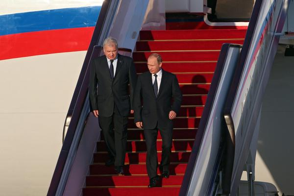 Russian President Vladimir Putin, right, arrives in Beijing on Sept. 2, 2015, to attend a military parade marking the end of World War II in Asia. (Wu Hong / European Pressphoto Agency)