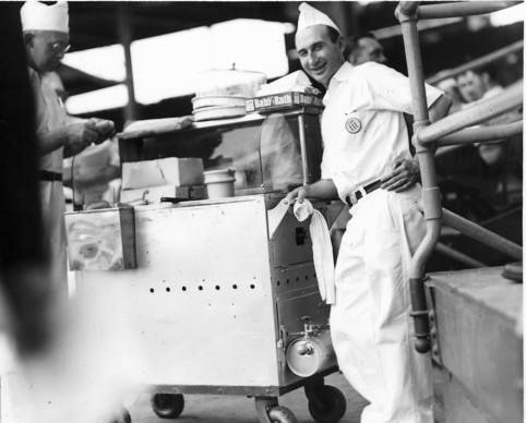 A Wrigley Field vendor sells food from a hot dog wagon in May 1938.