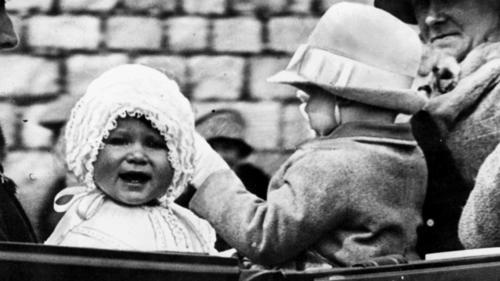 Little Princess Elizabeth, left, is shown in 1927. The picture was made as the baby princess was taken for a ride in the grounds of Windsor Castle, she is seen with her cousin, the honourable Gerald Lascelles, right, son of Princess Royal.