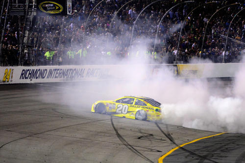 RICHMOND, VA - SEPTEMBER 12:  Matt Kenseth, driver of the #20 Dollar General Toyota, celebrates with a burnout after winning the NASCAR Sprint Cup Series Federated Auto Parts 400 at Richmond International Raceway on September 12, 2015 in Richmond, Virginia.  (Photo by Robert Laberge/Getty Images) ORG XMIT: 576865687