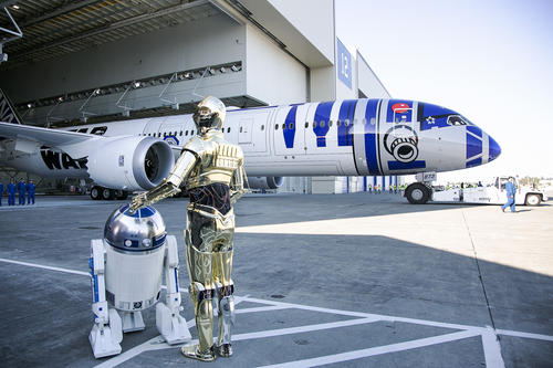 <p>Star Wars characters R2-D2 and C-3PO attend the unveiling of the R2-D2-themed All Nippon Airways 787 airplane at Paine Field in Everett, Wash. on Saturday, Sept. 12, 2015.</p>