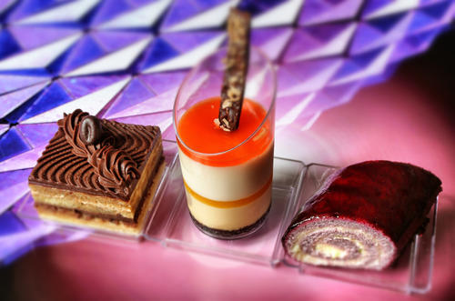 """Dessert Trio"" featuring Chocolate Espresso Opera Cake, Passion Fruit Coconut Creamsicle and Blueberry Lime Cheesecake Roll -- as various dishes are showcased during an Orlando Sentinel exclusive preview of the 2014 Epcot International Food & Wine Festival, photographed Friday, August 15, 2014, at Walt Disney World Resort.    (Joe Burbank/Orlando Sentinel)  	B583966798Z.1"