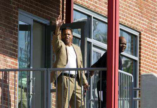 <p>Former U.S. Rep. Jesse Jackson Jr. waves to reporters as he leaves a halfway house in Baltimore on June 22, 2015. He's been living at the halfway house since his release from a federal prison in Alabama in March. He was convicted in 2013 of misuse of campaign funds.</p>
