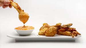 Cornmeal-fried spring onion with chile aioli