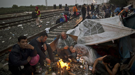 Migrants desperate for sanctuary in Europe pack trains