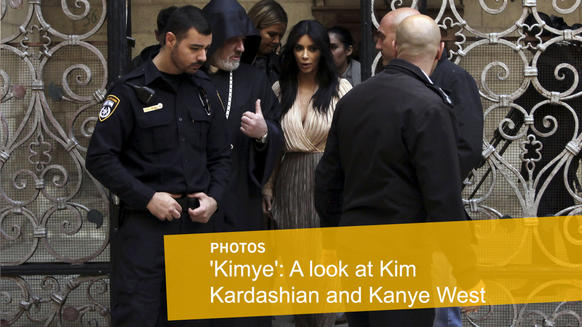 <p>Kim Kardashian walks inside Armenian St. James Cathedral in Jerusalem with husband Kanye West, their daughter, North, and sister Khloe Kardashian.</p>