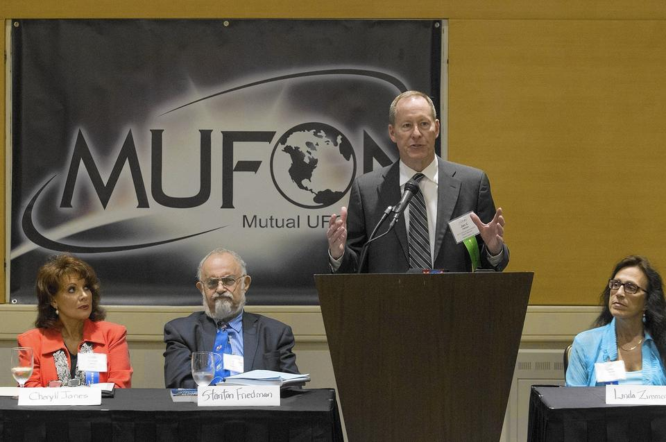 Mutual UFO Network Executive Director Jan Harzan speaks during his Newport Beach-based organization's 46th annual conference, held at the Hotel Irvine, on Friday.