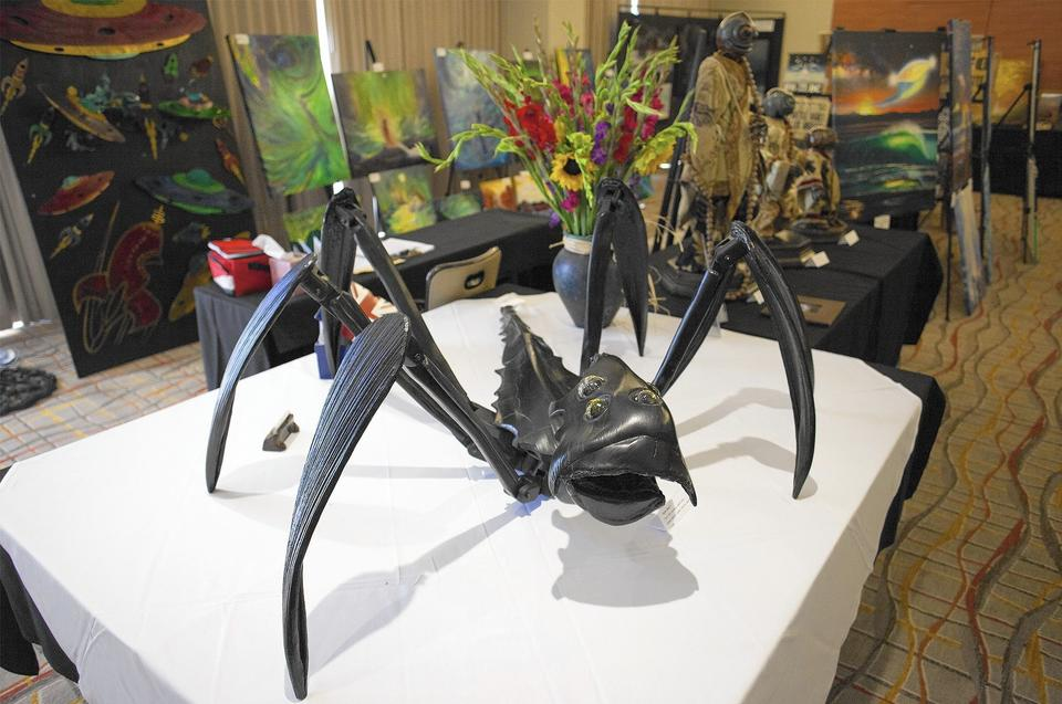 "An ""Alien Insect,"" by artist Manuel Cortez, was on sale during the Mutual UFO Network's conference at the Hotel Irvine on Friday."