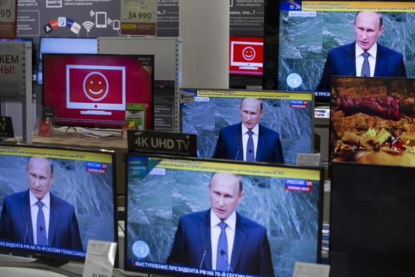 Television screens at an electronics shop in Moscow show Russian President Vladimir Putin at the United Nations General Assembly on Sept. 28. (Pavel Golovkin / Associated Press)