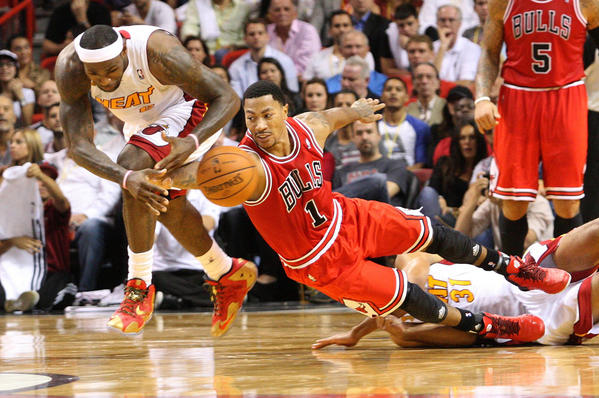 8b3d27e7b645 The Heat s LeBron James and Derrick Rose compete for a loose ball in the  third quarter. (Hector Gabino El Nuevo Herald MCT)