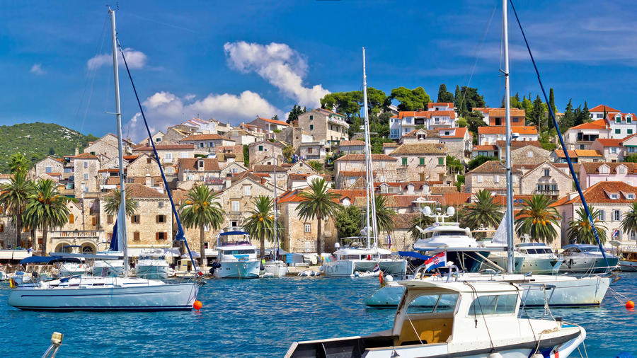 Sailing around the harbor of Hvar, an island off Croatia's Dalmatian Coast facing the Adriatic Sea