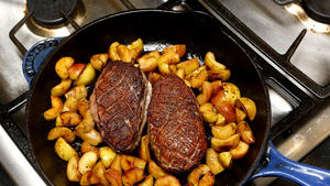Sauteed duck breasts with apple and tart greens