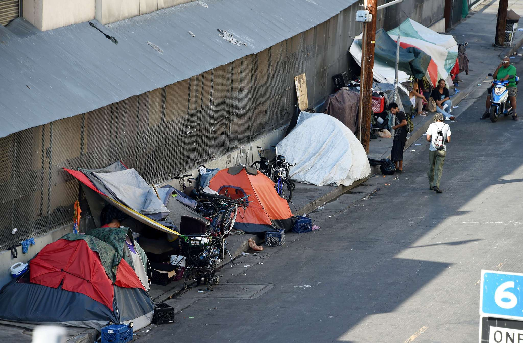 How should l a spend its 100 million homelessness for Homeless shelters los angeles