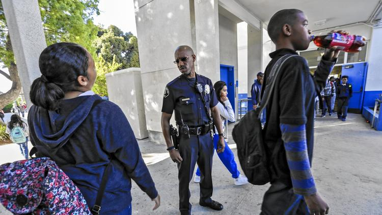 Los Angeles School police Officer Henry Anderson on his beat at Robert E. Peary Middle School in Gardena. (Irfan Khan / Los Angeles Times)