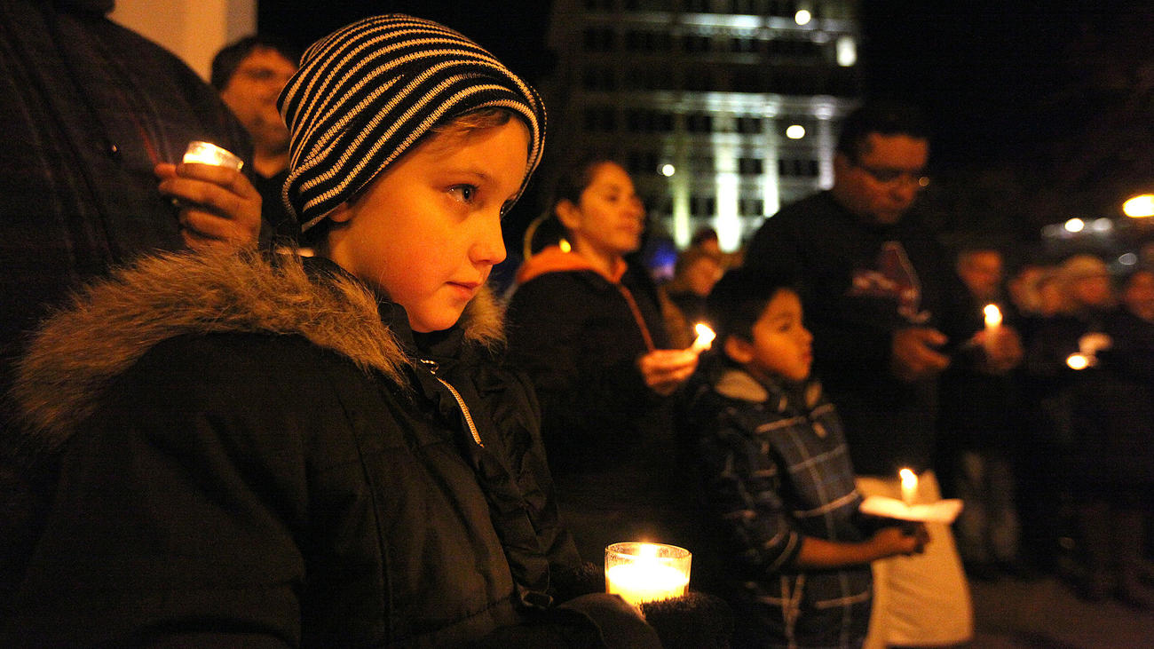 Easton lights peace candle early to honor Paris victims