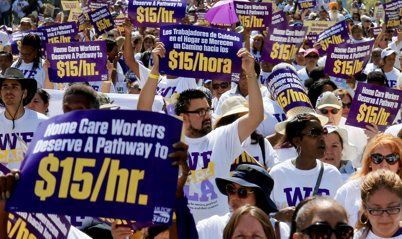 Workers demonstrate in favor a $15-an-hour minimum wage in Los Angeles in April.