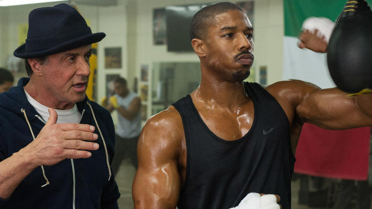 "Michael B. Jordan, right, is Adonis Johnson and Sylvester Stallone is Rocky Balboa in ""Creed."" (Barry Wetcher / Warner Bros.)"