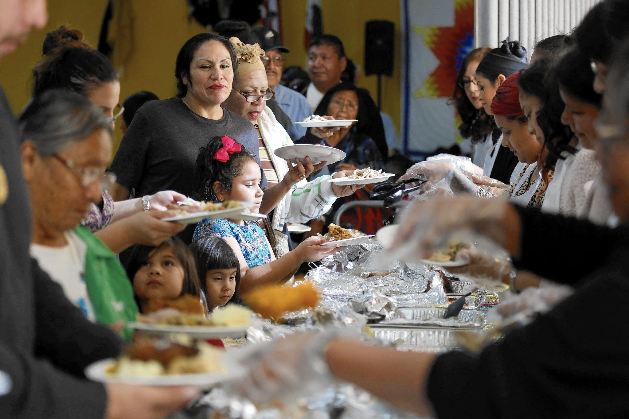 Native Americans mark Thanksgiving with mixed feelings, and a meal for those in need
