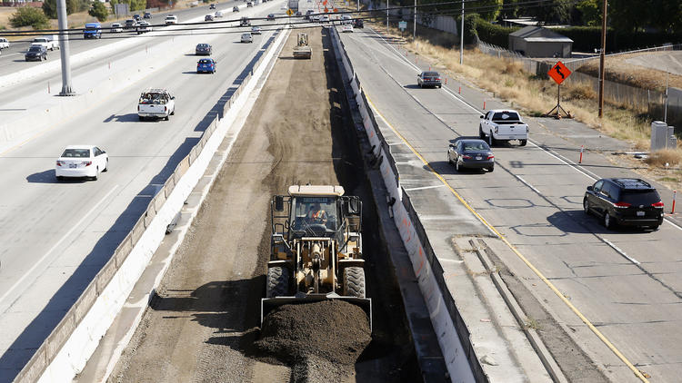 Vehicles pass a highway construction site on Interstate 80 in Sacramento last year. (Associated Press)