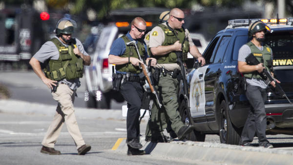 Police secure the scene of the mass shooting.  (Gina Ferazzi / Los Angeles Times)