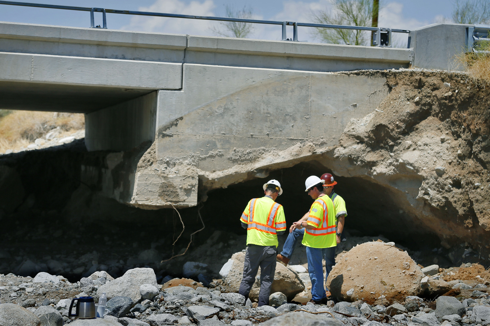 CalTrans inspectors assess the condition of the westbound bridge on Interstate 10 between Coachella and the Arizona border after a flash flood. (Los Angeles Times)