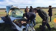 Photos: Helicopter removes downed plane from Mattaponi marsh