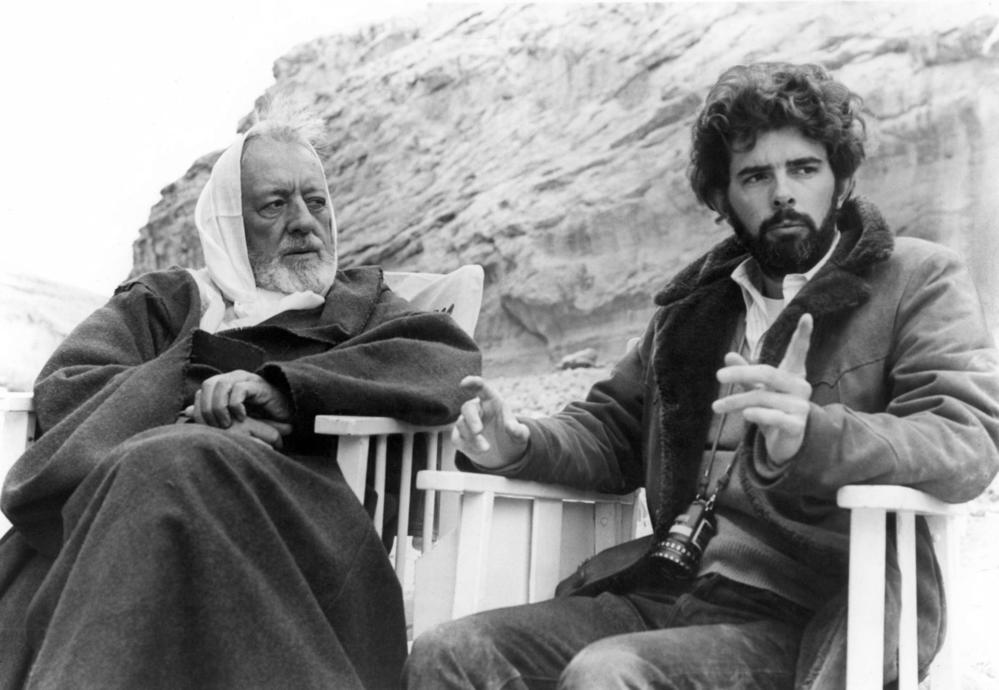 "Sir Alec Guinness, left as Ben Kenobi listens to director George Lucas on the set of the 1977 blockbuster ""Star Wars."" (20th Century Fox)"