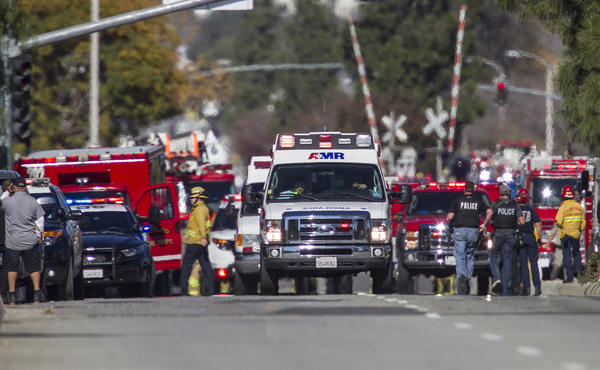 Ambulances leave the shooting scene last week. (Gina Ferrazzi / Los Angeles Times)