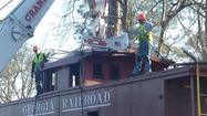 Cranemasters lift George Railroad caboose to Norge Depot