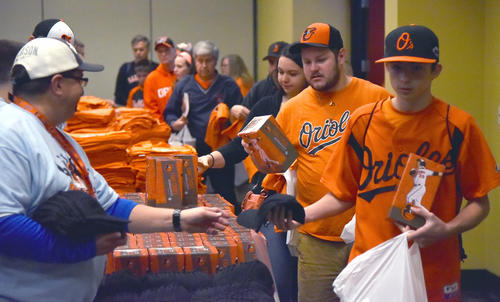<p>Orioles fans collecting giveaways at FanFest at the Baltimore Convention Center on Saturday, Dec. 12, 2015.</p>