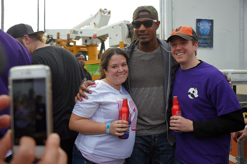 <p>Orioles center fielder Adam Jones poses with Marina Baer and her husband Josh Baer of Annapolis during a tailgate party to aid low-income families before the Ravens game against the Seattle Seahawks.</p>