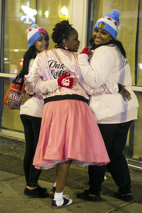 The Pink Ladies from left for right, Mandy, Selena, and Nancy at the 20th annual Twelve Bars of Christmas in Wrigleyville on Saturday, December 12, 2015. (Brittany Sowacke for RedEye)