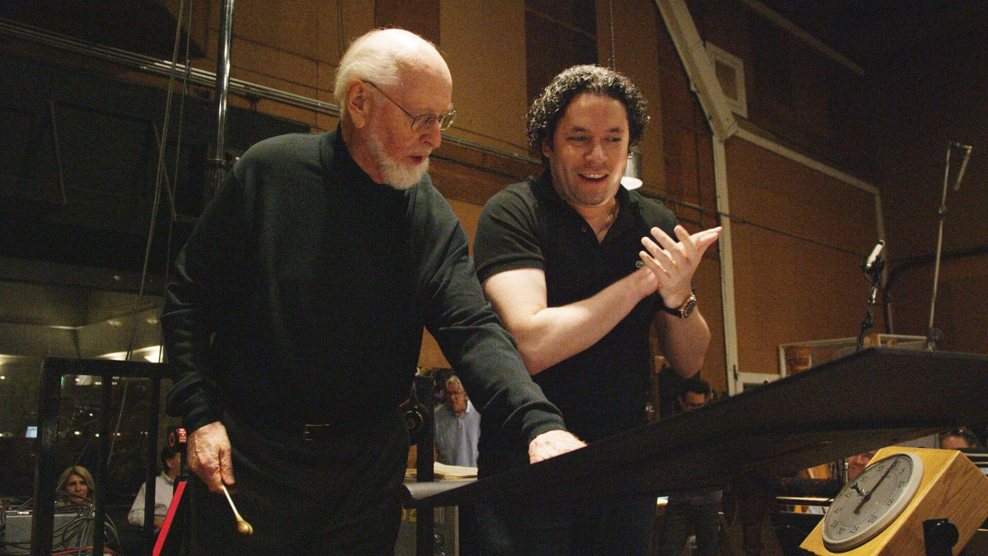 Composer John Williams, left, confers with conductor Gustavo Dudamel about the score for