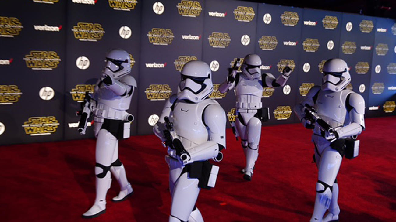Stormtroopers drink in the spotlight on the red carpet -- while keeping order, of course. (Jay L. Clendenin / Los Angeles Times)
