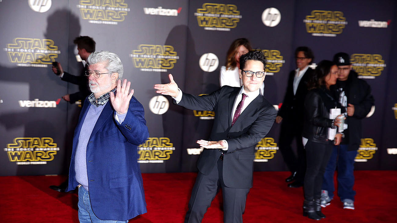 J.J. Abrams acknowledges George Lucas as he continues down the carpet toward the Hollywood premiere of