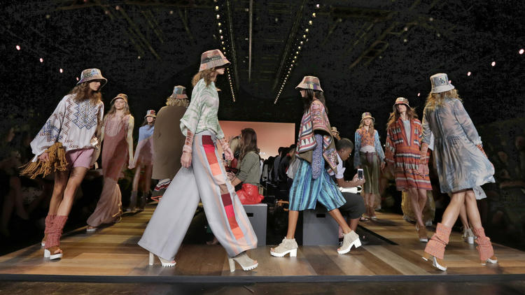 Fashion models show off the BCBG MAX AZRIA Spring 2016 collection during New York Fashion Week. (Richard Drew / AP)