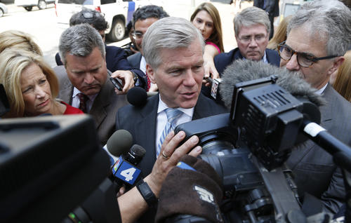 <p>Former Virginia Gov. Bob McDonnell, center, answers reporters questions as he leaves the 4th U.S. Circuit Court of Appeals after a hearing the appeal of his corruption conviction in Richmond, Va., Tuesday, May 12, 2015. (AP Photo/Steve Helber)</p>