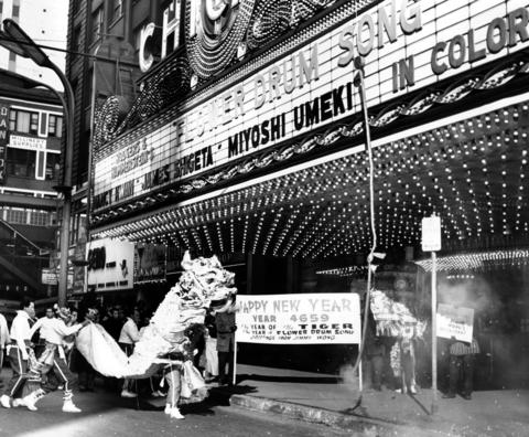AChinese dragon prowls State Street in front of the Chicago Theatre in February 1962. The dragon was Jimmy Wong's salute to the Chinese New Year 4659 in February 1962.Wong was a famous restaurant owner in Chicago.