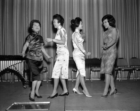 Mrs. Ann Leong, Miss Mary Jane Dea, Miss Sue Ling Gin and Mrs. Celia Cheung do the twist at a Chinese New Year party held at the Congress Pick Hotel on Feb 10,1962.