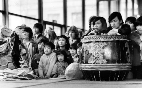 """A crowd watches as children from the Haines Elementary School in Chinatown perform a traditional lotus dance during a Chinese """"Year of the Rooster"""" festival sponsored by the Chicago Council on Fine Arts at the Daley Center on Feb. 5, 1981. The celebration marks the Chinese year 4679."""