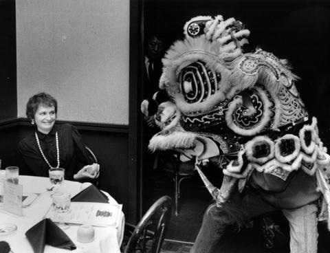 A luncheon patron wears an expression of uncertainty as a Chinese lion sits near her table to celebrate the start of the Chinese New Year on Feb. 7, 1986. The lunar year 4684 is the year of the tiger. The traditional dance was staged at the Szechwan House, 600 N. Michigan Avenue.