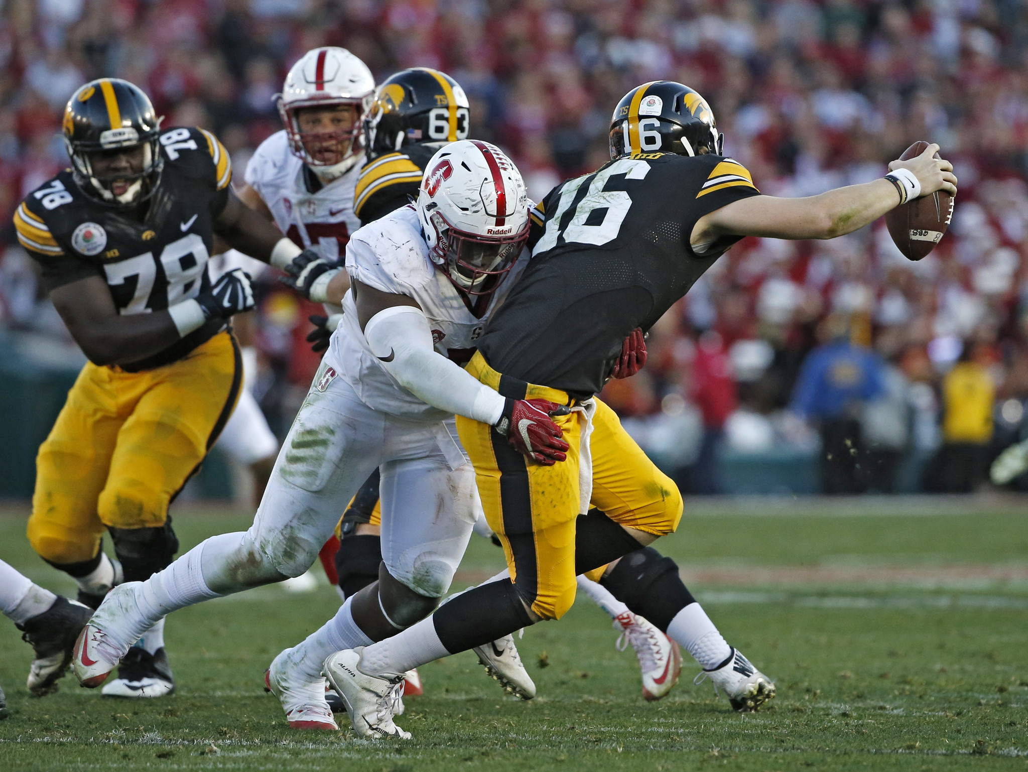 C.J. Beathard is sacked by Stanford defensive end Aziz Shittu. (Lenny Ignelzi / AP Photo)
